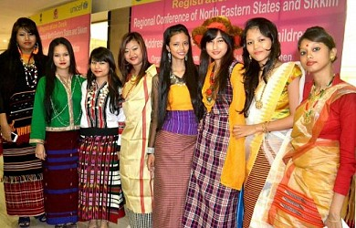 Girls dressed in the traditional attire of their respective states at NE Regional Conf addressing Trafficking of Women and Children in Guwahati on Aug 27