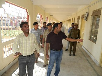 DM Abhishek Singh with SDM busy checking the Strong Room of Lok Sabha Election at Umakanta School. TIWN Pic March 8