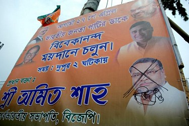 Cut mark on BJP leader Subal Bhowmik found in BJP banners. TIWN Pic Apr 26