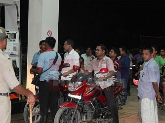 Long queues observed at Dharmanagar Petrol Pump at midnight. TIWN Pic July 30