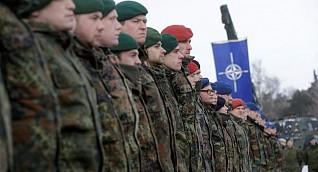 Russia warns of action against NATO forces near its border