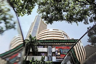 Sensex, Nifty hit record highs on firm global cues, rupee recovery