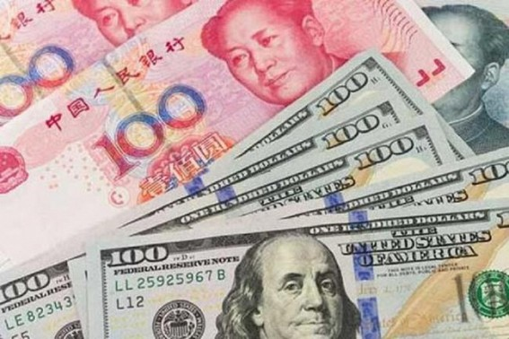 China's yuan edges higher against US dollar