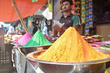 A shop-keeper selling colours on the occasion of holi at Agartala. TIWN Pic March 20