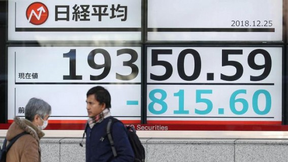 Japan's Nikkei rises on strong Wall Street