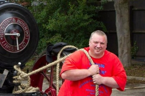 UK strongman with 14 world records dies at 47