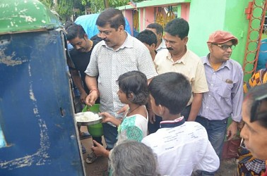 MLA Sudip Barman distributing food to flood affected people. TIWN Pic July 15