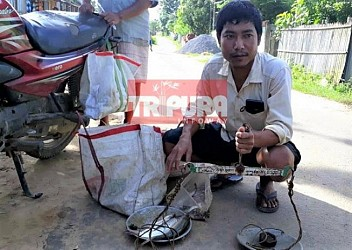 10323 Teacher Manoj Debbarma has become Fish-seller in Burmira Madhabkami Para. TIWN Pic July 9